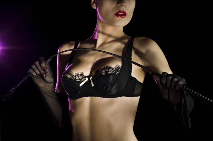Woman in black PVC bra