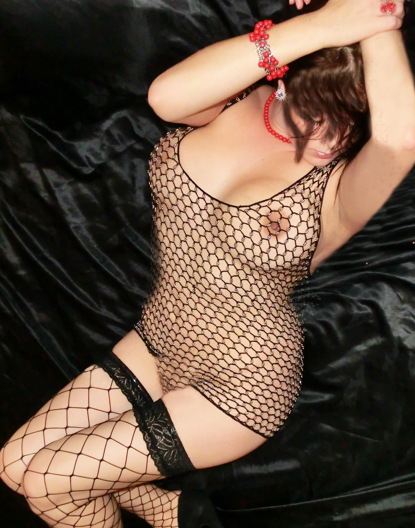 busty brunette in fishnet