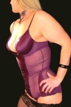 Mature Blonde female in purple basque