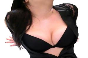 Busty curvy woman in black underwear
